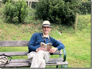 Neal reading Agatha Christie in Greenway garden, overlooking the River Dart